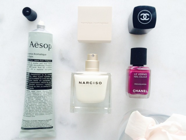 Aesop hand balm, Narciso perfume, Chanel nail polish provocative